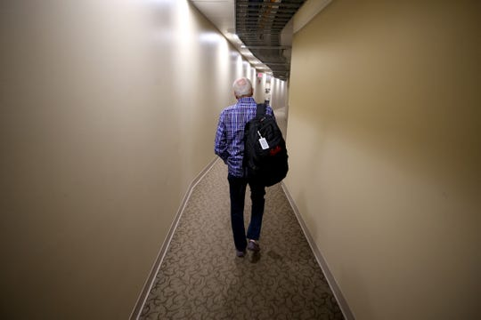 Cincinnati Reds Hall of Fame broadcaster Marty Brennaman walks through the hallway on his last day before he retires after 46 years in the booth, Thursday, Sept. 26, 2019, at Great American Ball Park in Cincinnati.