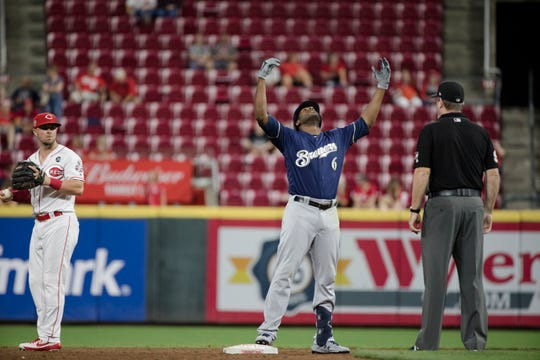 Milwaukee Brewers center fielder Lorenzo Cain (6) celebrates after hitting a double during the MLB game between Cincinnati Reds and Milwaukee Brewers at Great American Ball Park in Cincinnati on Wednesday, Sept. 25, 2019.