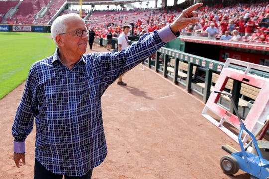 Cincinnati Reds Hall of Fame broadcaster Marty Brennaman, waves to the fans during pregame ceremonies on his last day before he retires after 46 years in the booth, Thursday, Sept. 26, 2019, at Great American Ball Park in Cincinnati.