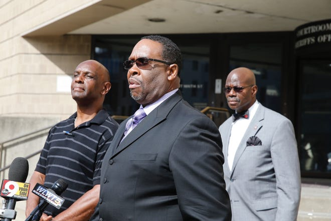 Bishop Bobby Hilton and Cecil Thomas speak to the media on an early release for Tracie Hunter.