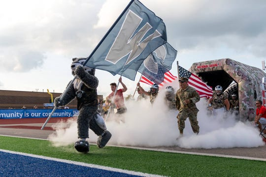 West Clermont enters the field on Sept. 6 wearing Camouflage uniforms for the National Guard Game of the Week.
