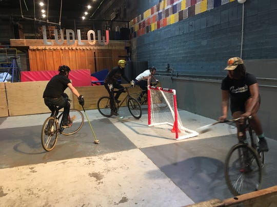 Bicyclists use mallets to play bike polo Feb. 7, 2019, inside Bircus Brewing Co. in the Ludlow Theatre.