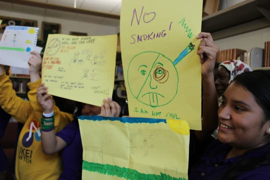 Students at Aiken High School show off the posters they made to help start a new anti-smoking and anti-vape campaign in Cincinnati schools.