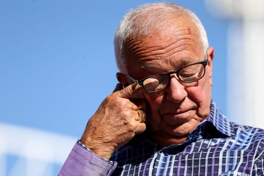 Cincinnati Reds Hall of Fame broadcaster Marty Brennaman wipes away tears during postgame ceremonies commemorating his retirement after 46 years in the booth, Thursday, Sept. 26, 2019, at Great American Ball Park in Cincinnati.
