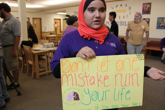 Sidra Masto, 14, a freshman at Aiken High School, shows off the poster she made to help kick off a new anti-smoking and anti-vape campaign in four Cincinnati schools.