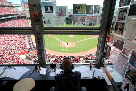 Cincinnati Reds Hall of Fame broadcaster Marty Brennaman calls the game in the fourth inning on his last day before he retires after 46 years in the booth, Thursday, Sept. 26, 2019, at Great American Ball Park in Cincinnati.