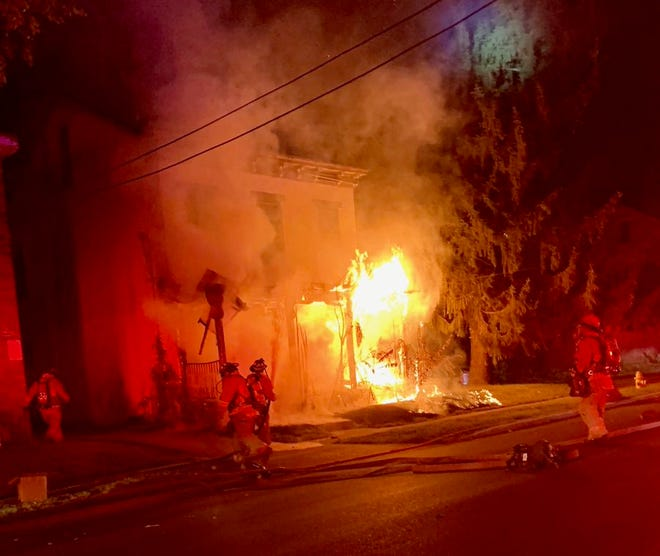 Flames gorge a vacant home on Regent Avenue in Bond Hill early Thursday, September 26, 2019.