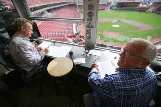 Cincinnati Reds Hall of Fame broadcaster Marty Brennaman talks with color analyst Jeff Brantley on his last day before he retires after 46 years in the booth, Thursday, Sept. 26, 2019, at Great American Ball Park in Cincinnati.