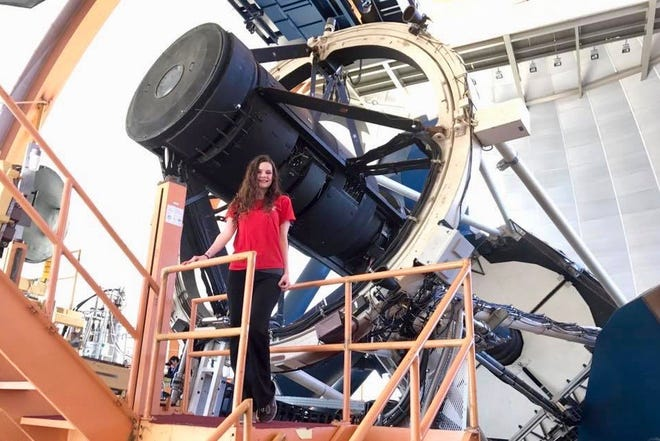 Gulledge stands in front of the Blanco 4m telescope at the Cerro Tololo Inter-American Observatory in Chile during her time as an undergraduate with the Dark Energy Survey.