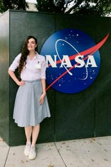 Gulledge stands in of the NASA Jet Propulsion Laboratory's sign, where she was an intern earlier this year, working on real-time atmospheric correction for ground-based telescopes.