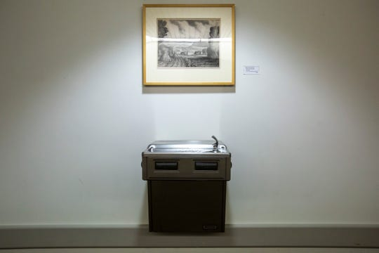 "John Curry Stewart's ""Valley of Wisconsin"" hangs in a hallway on the third floor above a drinking fountain, Wednesday, Sept., 25, 2019, at the University of Iowa Hospitals and Clinics (UIHC) in Iowa City, Iowa."