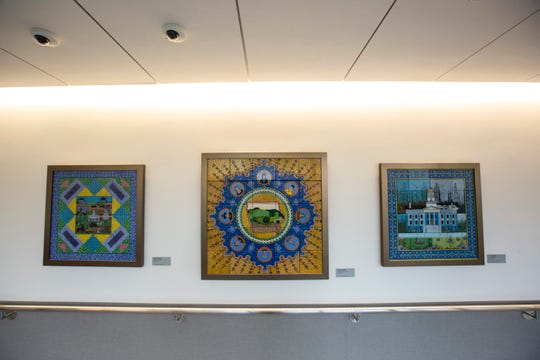 "Jafar Mogadam's ""Children of the World"" ceramic tile art piece, that features the outline of the state of Iowa in the center, hangs in a hallway, Wednesday, Sept., 25, 2019, at the University of Iowa Hospitals and Clinics (UIHC) in Iowa City, Iowa."