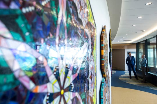 "Jon Darsee and UIHC Project Art Director Bruce Scherting look at Barbara ""Bebe"" Keith's ""Kalaidoscopes"" (cq) mixed media mosaic art piece in a hallway, Wednesday, Sept., 25, 2019, at the the 12th floor of the Stead Family Children's Hospital in Iowa City, Iowa."