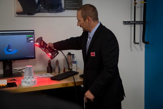 Mark Williamson demonstrates new scanning technology during the opening of ISU's digital manufacturing lab, CIRAS, on Thursday, Sept. 26, 2019 in Ames. The center was funded with a $100,000 contribution from Alliant Energy and $250,000 from the Iowa Economic Development Authority.ISU digital manufacturing lab opening on Thursday, Sept. 26, 2019 in Ames.
