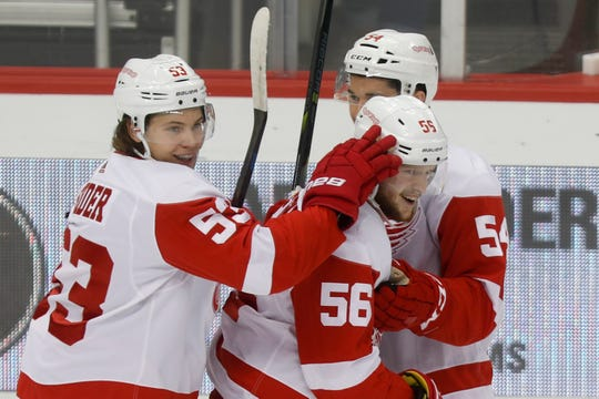 Detroit Red Wings' Ryan Kuffner (56) celebrates with teammates Moritz Seider (53) and Matt Puempel (54) after scoring against the Pittsburgh Penguins during the first period of an NHL preseason hockey game, Wednesday, Sept. 25, 2019, in Pittsburgh.
