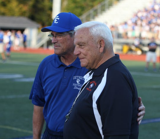 Catholic Central coach Tom Mach, left, talks with Brother Rice coach Al Fracassa before a game Sept. 28, 2013.