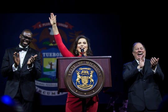 Governor Gretchen Whitmer speaks next to Lieutenant governor Garlin Gilchrist II and Detroit mayor Mike Duggan during the inaugural ball at Cobo Center in Detroit, Tuesday, Jan. 1, 2019.