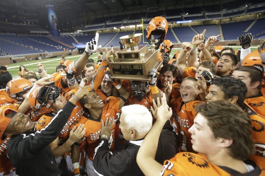 Brother Rice celebrates their win over Catholic Central during their Catholic League Championship game at Ford Field on Oct. 26, 2013 in Detroit.