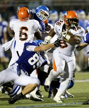 Dylan Roney tackles Brian Walker, Sept. 28, 2013 at Catholic Central.