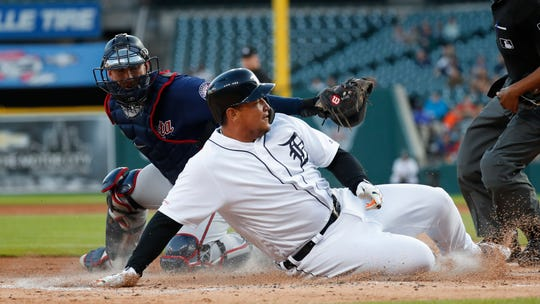 Detroit Tigers' Miguel Cabrera slides safely past the tag of Minnesota Twins catcher Mitch Garver to score at home plate in the first inning of a baseball game in Detroit, Wednesday, Sept. 25, 2019. (
