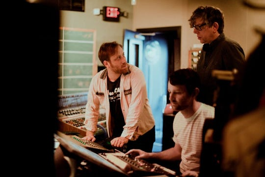 The Black Keys' Dan Auerbach (left) and Patrick Carney (right) with recording engineer Allen Parker.