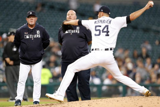 Detroit Tigers manager Ron Gardenhire (left) and head athletic trainer Doug Teter (middle) watch starting pitcher Drew VerHagen (54) warm up after getting hit by a line drive from Minnesota Twins right fielder Eddie Rosario (not pictured) during the fourth inning at Comerica Park on Wednesday, Sept. 25, 2019.