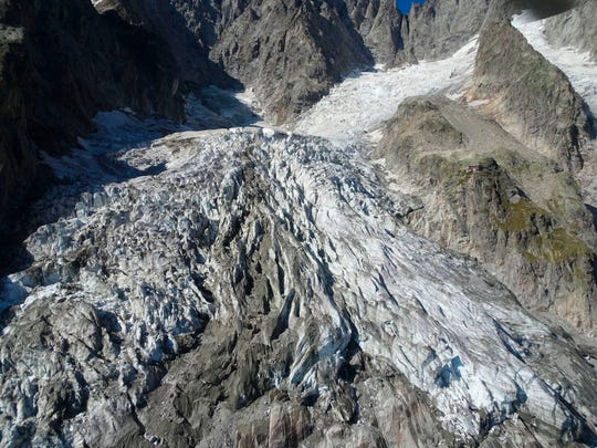 This photo taken on Friday, Sept. 20, 2019 shows the massive Planpincieux glacier, located in the Alps on the Grande Jorasses peak of the Mont Blanc massif, which straddles the borders of Italy, France and Switzerland and contains the highest peak in Western Europe.