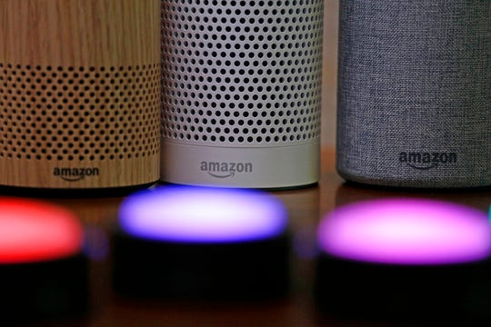 In this Sept. 27, 2017, file photo, Amazon Echo and Echo Plus devices, behind, sit near illuminated Echo Button devices during an event announcing several new Amazon products by the company in Seattle. Users of Amazon's Alexa digital assistant can now request that recordings of their voice commands delete automatically.