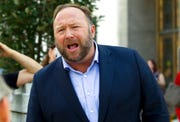 In this Sept. 5, 2018, file photo conspiracy theorist Alex Jones speaks outside of the Dirksen building of Capitol Hill in Washington.
