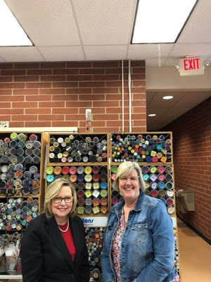 Candy Fink, left, and Tracey Maris are owners of Yarn Envy in Ottawa Lake.