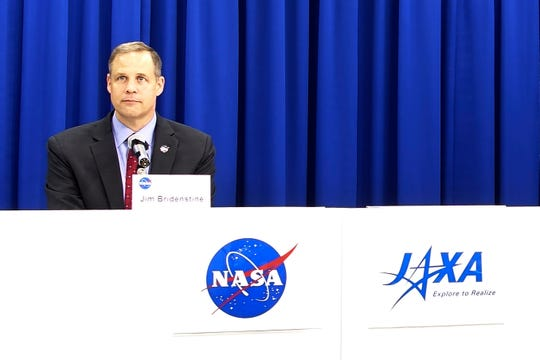 NASA administrator Jim Bridenstine attends a press conference at the Japan Aerospace Exploration Agency (JAXA) headquarters in Tokyo Wednesday, Sept. 25, 2019. Bridenstine said space security is necessary so that the United States, Japan and other allies can safely explore the moon and Mars explorations. Bridenstine said NASA said that gadgets using the space technology have become indispensable part of the people's lives and its safety must be preserved.