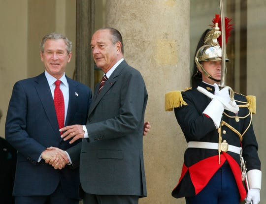 President George W. Bush meets with French President Jacques Chirac as a French honor guard member stands guard at the Elysee Palace in Paris on June 5, 2004.