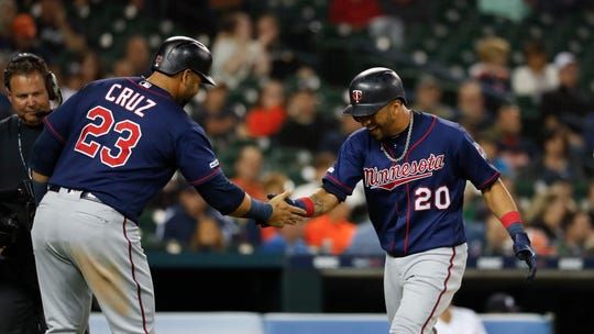 The Twins' Eddie Rosario (20) celebrates his two-run home run with Nelson Cruz (23) in the eighth inning.