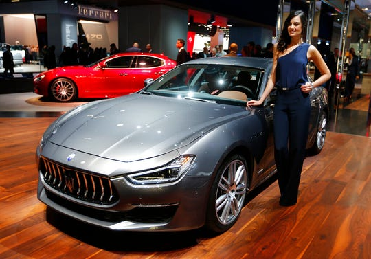 Maserati said its highly successful four-door Ghibli sedan will be the first of its models produced with a hybrid powertrain.