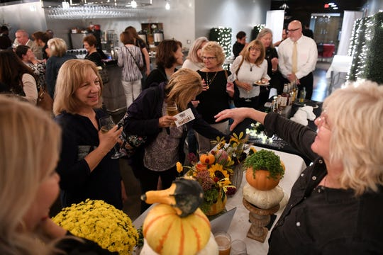 Jenifer Kueber of Olive's Bloombox, right, talks about the decorating ideas for fall at the Homestyle Harvest Dish and Design event at the Great Lakes Culinary Center in Southfield, Mich. on Sept. 25, 2019.