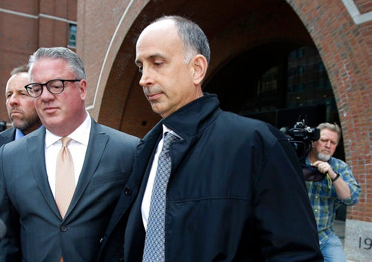 In this May 7, 2019 file photo, California businessman Stephen Semprevivo departs federal court in Boston, after pleading guilty to charges that he bribed the Georgetown tennis coach to get his son admitted to the school.