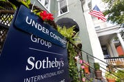 An under contract sign is displayed by a home in Richmond, Va.