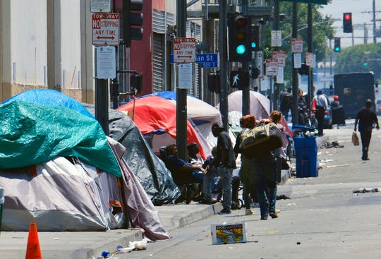 In this May 30, 2019 file photo, tents housing homeless line a street in downtown Los Angeles. The EPA says California is falling short on preventing water pollution, largely because of its problem with homelessness.