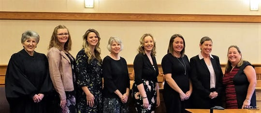 A new groups of volunteers has graduated to be CASA volunteers. Left to right are Judge Giesler, Ashley Walterbusch, Annie Hild, Amy Young, Cassidy Steinmetz, Maggie Meterko, Treena Baer and Connie Cornett, Executive Director.