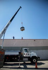 A crane lifts a new air conditioning unit onto the roof of the Southwest Florida Military Museum & Library on Wednesday, September 25, 2019, in Cape Coral. The new AC unit was donated by Ellsworth's and installed for free. A new compressor for the building's main AC unit was also donated and installed for free by TWC Services and Conditioned Air employees.