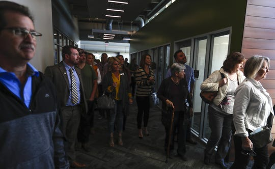 A scene of builders, realtors and developers observing different parts of the building during the tour given by the Realtors Association of Northeast Wisconsin to show present and future areas of interest in Brown County on Thursday, Sept. 26, 2019, at the STEM Innovation Center on UWGB campus in Green Bay, Wis. Ebony Cox/ USA TODAY NETWORK-Wisconsin