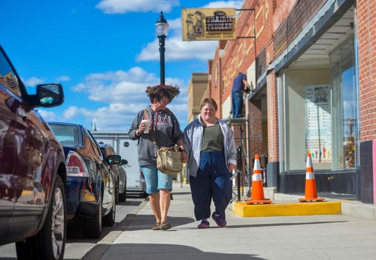 Corinne Kanning walks with her daughter Jordan Bludworth on Main Street in Shelby, Wednesday Sept. 25, 2019. Jordan has recently been diagnosed with Alzheimer's Disease.