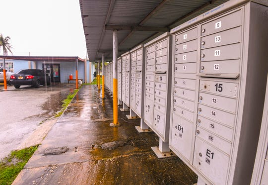 A long row of cluster mailboxes can be seen near the Yona mayor's office on Thursday, Sept. 26, 2019.