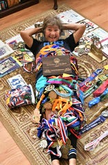 Anna Pangelinan lays among the dozens - maybe even hundreds - of medals and ribbons she's earned since joining competitive races in the 80s. The iron woman has also completed a handful of marathons and half-marathons.