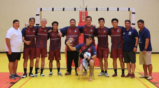 The Bank of Guam Strykers pose with the champions trophy of the Budweiser Futsal League following the team's 11-7 win over Guam Shipyard in the final match Sunday at the Guam Sports Complex Gym.