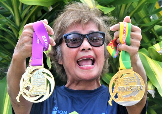 Of the dozens of medals and ribbons she's earned in almost a half-century of running, 71-year-old Anna Pangelinan is most proud of these - medals for finishing marathons.