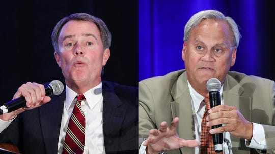 From left, Indianapolis Mayor Joe Hogsett and his Republican challenger Sen. Jim Merritt, at a moderated discussion on homelessness in Indianapolis, Wednesday, Sept. 25, 2019.