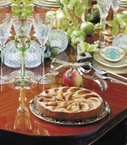 The sunken apples and honey tart is a dessert recipe that cookbook author Susie Fishbein considers a perfect choice for celebrating the Jewish New Year or Rosh Hashanah. (Photo provided by Martino & Binzer marketing and public relations firm.)