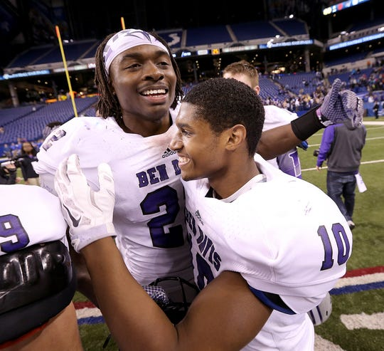 Ben Davis Asmar Bilal, left, celebrates with Chaz Stringer, right, following their Class 6A title title game win over Carmel in 2014.