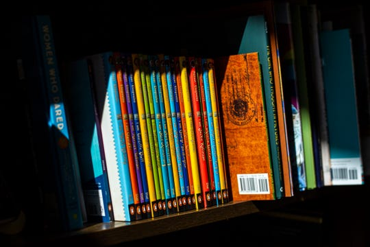 A beam of light casts on a section of books near a seating area at Sidekick Coffee & Books, Thursday, Sept., 26, 2019, at 1310 1/2 Melrose Avenue in University Heights, Iowa.